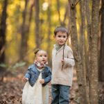 children in the woods playing with sticks, whimsical