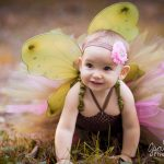 little girl dressed as a fairy in a tutu for 1st birthday