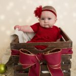 6 month old holiday, christmas photo. baby in prop with bow