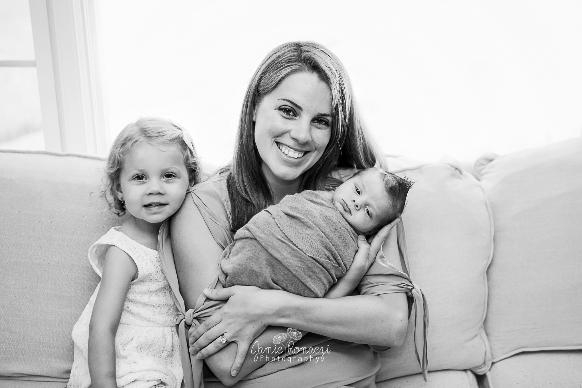 Black and white family photo, mom sister and baby