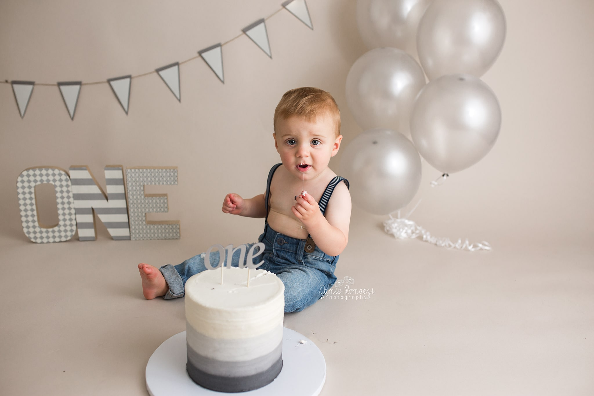 Gray Ombre themed first birthday cake smash session with balloons